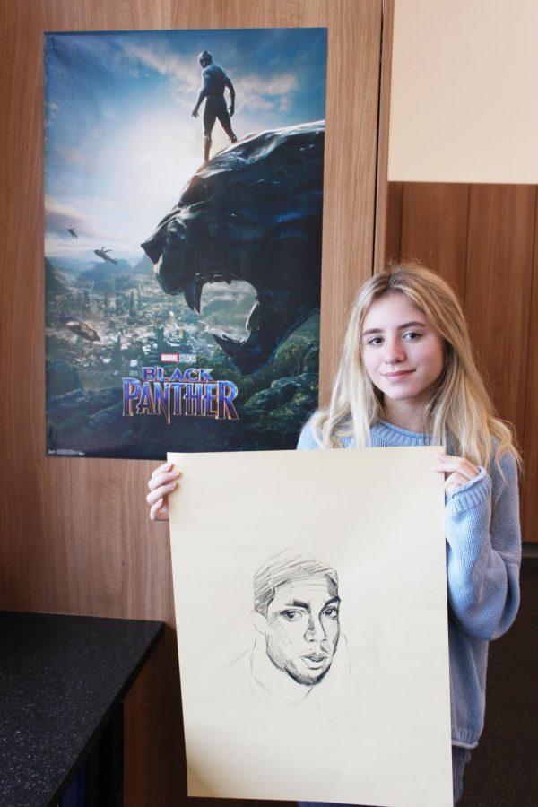 Sophia McQueen (10) displays her original sketch of Chadwick Boseman in Ms. Riedy's Advanced Drawing class.