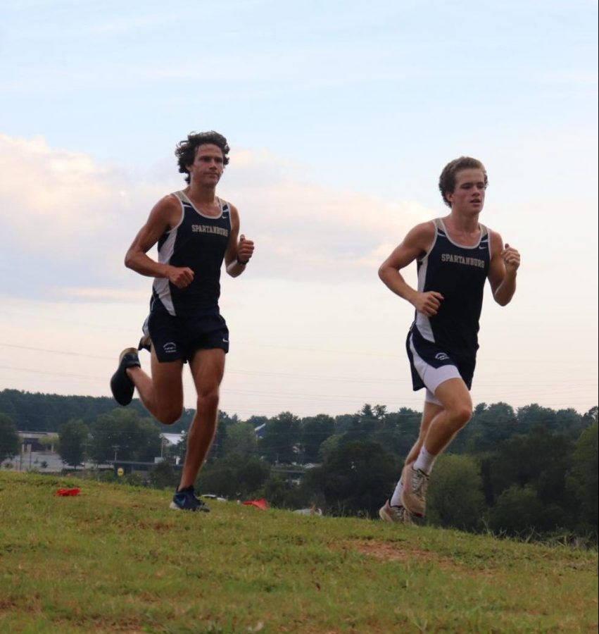 Running together, top Viking runners Mac Salley (11) and John Bolinger (11) fly through the new cross country course.