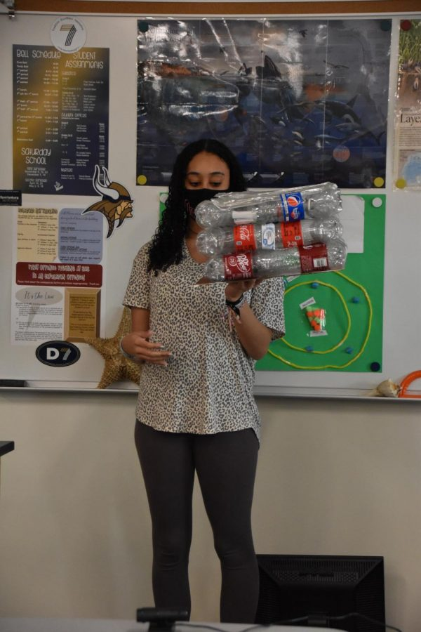 Recycled household items were reused into something new and presented to the class.