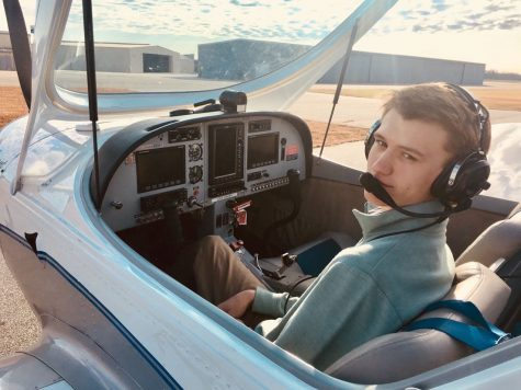 Preparing for takeoff, Hammett Anderson sits in the cockpit before taking to the skies.