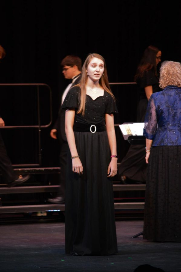 Anna Becknell (11) multi-talented musician, performing a solo in an SHS choir concert.