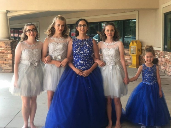 Cisne Idrovo poses with the damas in her court and a younger family friend, who Idrovo calls her