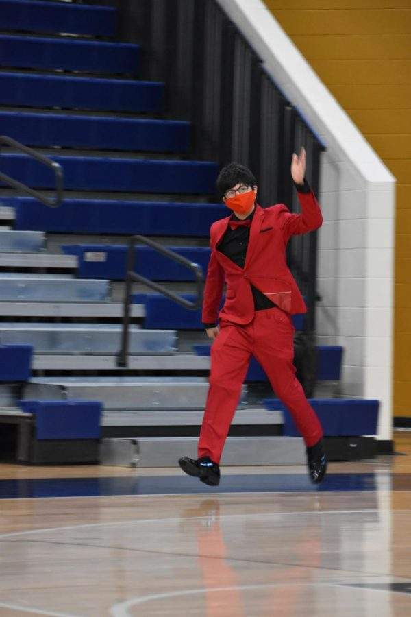 Anthony Idrovo (12) waves to the crowd before the Homecoming King is announced.