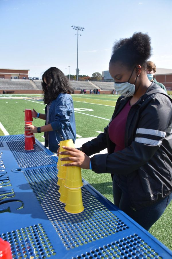 Two Viking students race each other in a cup stacking competition.