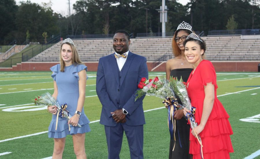 The Homecoming Court poses with Principal Vance Jones after being crowned.