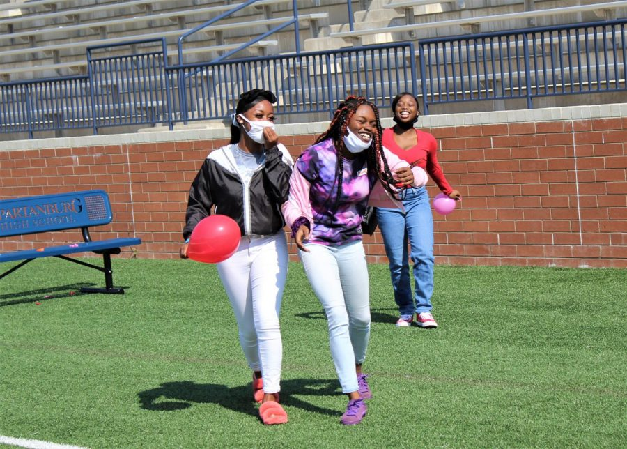 Friends share a laugh during Friday Fun Lunch.  The games on the field were a favorite for many students.