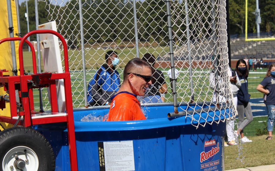 Assistant Principal Jeff Boucher gets dunked by a student during Friday Fun Lunch.