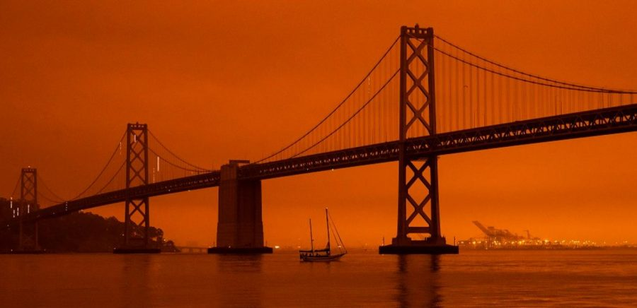 Air pollutants bring an orange haze surrounding the Golden Gate Bridge in San Fransisco, CA.