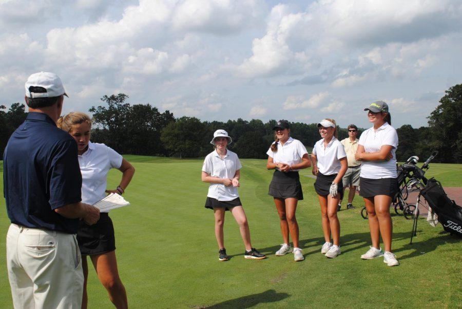 The girls' golf team prepares for their match against Riverside.