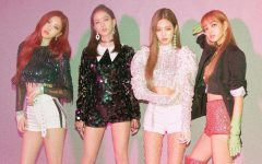 With their glittery costumes and pastel pink highlights, the K-Pop members of BLACKPINK pose for a picture. The group has a huge American following and performed at Coachella in 2019.