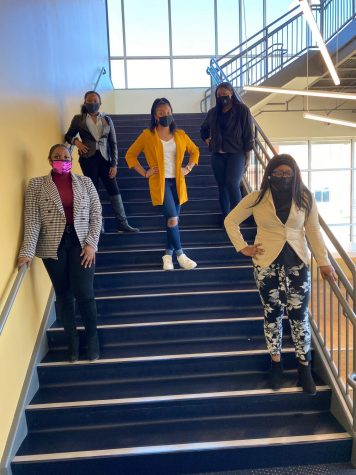 "Black History Club members display their ""Too Fresh Tuesday"" suits."
