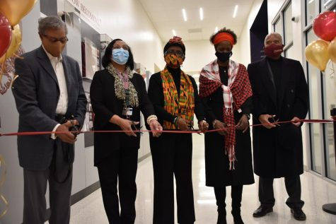 Graduates of Carver High School cut the ribbon to the newly-installed history wall at Spartanburg High School.