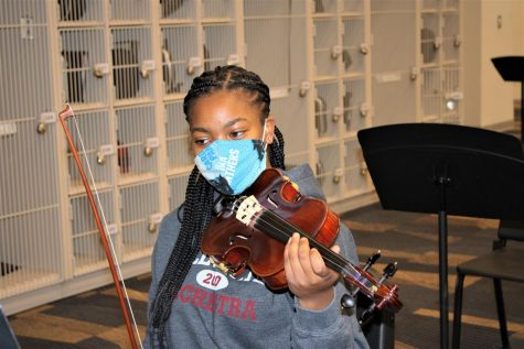 First violin in the Symphony Orchestra Nadia Ferguson (12) practices a piece for Region.