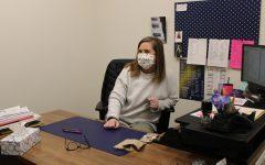 Guidance counselor, Lauren Jones, speaks to a student in her office.