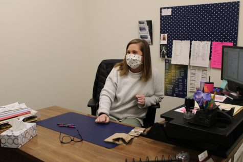 Guidance counselor, Lauren Jones, speaks to a student in her office.