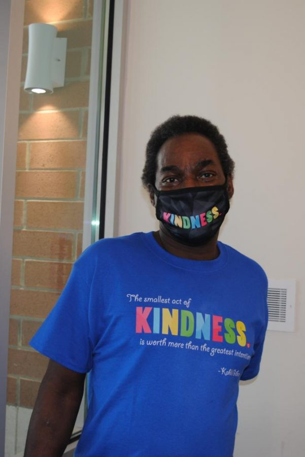 Jo Johnson embraces Kindness Month by wearing his kindness gear.