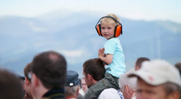 Examples of ways that public events can accommodate those with hypersensitivity to noise is by providing noise-cancelling headphones at events like concerts and sports games.