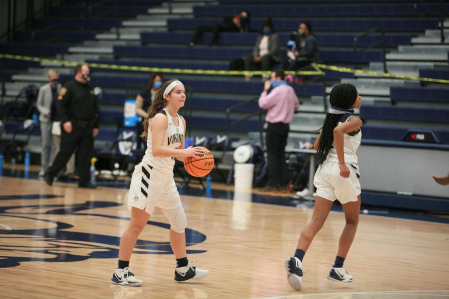Varsity freshman point guard, Eliza Phillips pulls up for three from the arch.