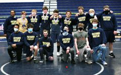 Members of the Varsity Wrestling team celebrate their third place finish at the Regional meet.