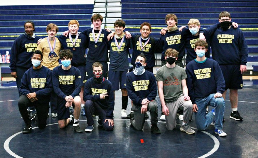 Members+of+the+Varsity+Wrestling+team+celebrate+their+third+place+finish+at+the+Regional+meet.