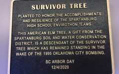 The plaque at the bottom of the newly planted tree details Spartanburg Soil and Water's generous donation.