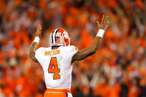 After throwing another touchdown for the Tigers, quarterback Deshaun Watson celebrates during the 2016 CFP National Championship.