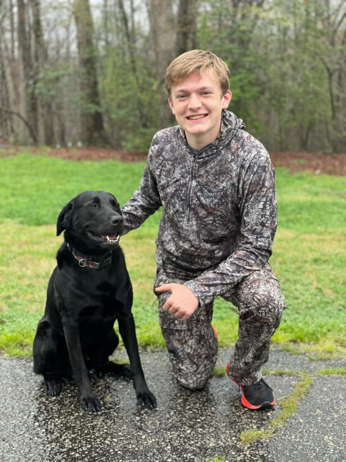 Mills Bullington (9) likes to take his dog Saluda with him when he goes hunting.