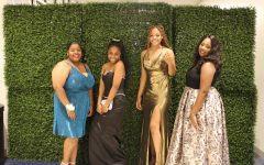 Students pose for a picture in their prom dresses before hitting the dance floor.