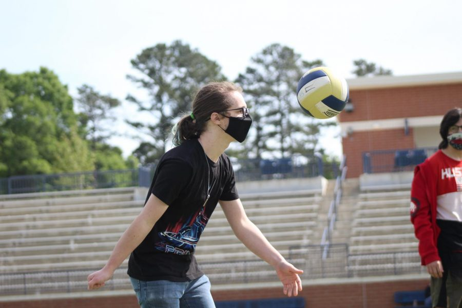 Tristan Wilcox serves the ball during the volleyball tournament