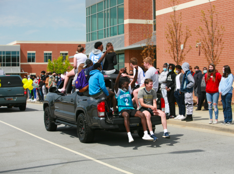 Seniors paraded on decorated cars to celebrate the end of their high school academic careers.