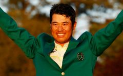 After winning the 2021 Masters Tournament, Hideki Matsuyama celebrates in his Green Jacket.