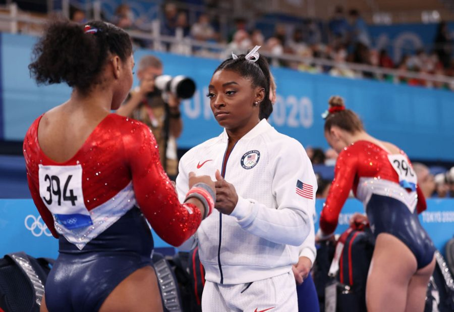 Simone Biles speaks with Jordan Chiles at the 2020 Tokyo Olympics on July 27, 2021.