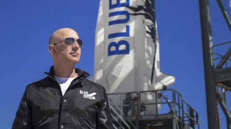 Jeff Bezos stands in front of his space shuttle minutes before lift off.