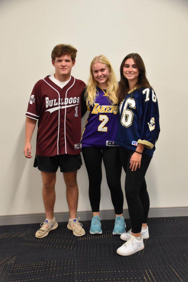 Mac Russell (11), Ellen Fields (11) and Mary Jordan Janeski (11) show off their favorite jerseys.