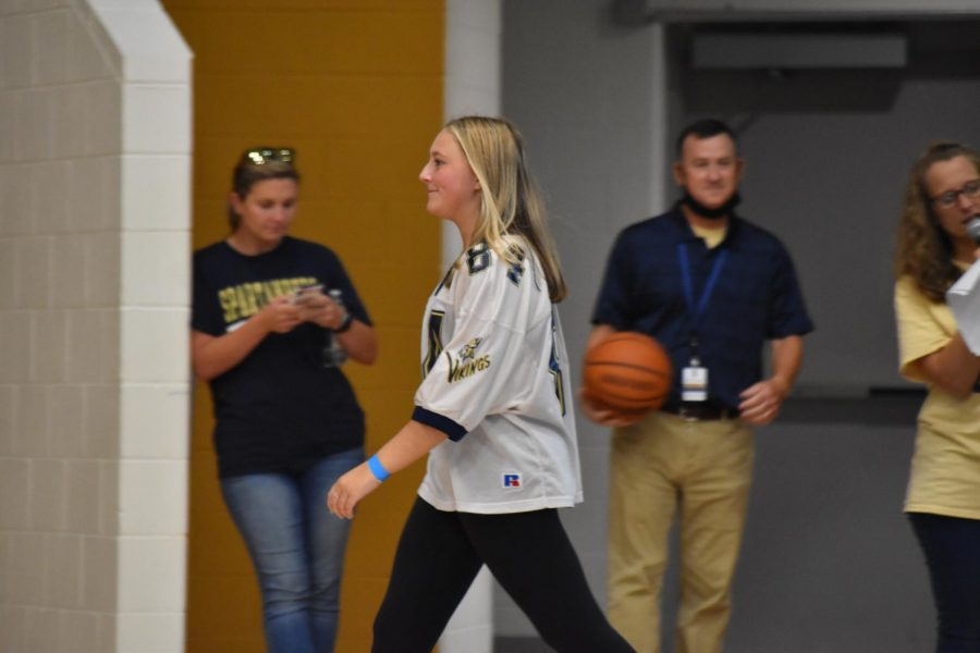 Caroline Patrick (12), a Homecoming queen candidate, walks onto the court during Fun Lunch.