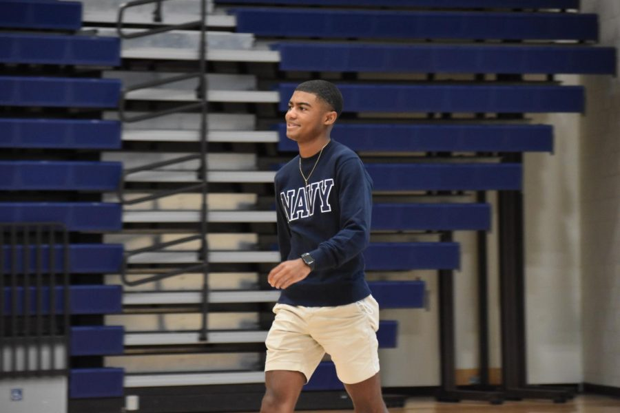 Maxwell Booker (12), a Homecoming king candidate, walks onto the court during Fun Lunch.