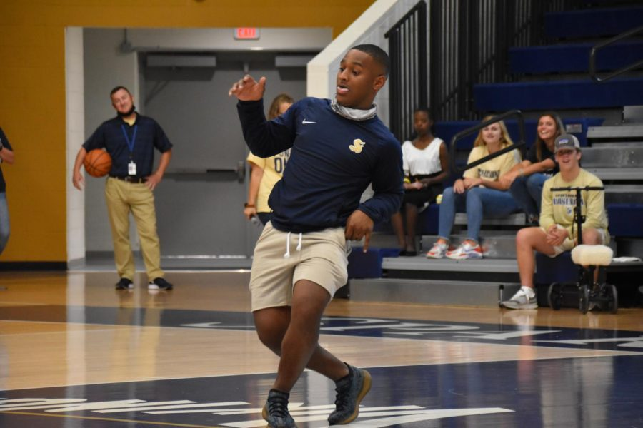 Homecoming King candidate Kanye Richards (12) displays signature dance moves as his name is announced during Fun Lunch.