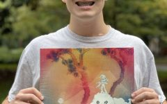 Florian Sloan (12) poses with a vinyl of KIDS SEE GHOSTS.