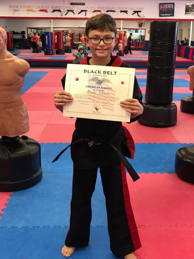 Brady Johnson received his black belt certificate at age 10.