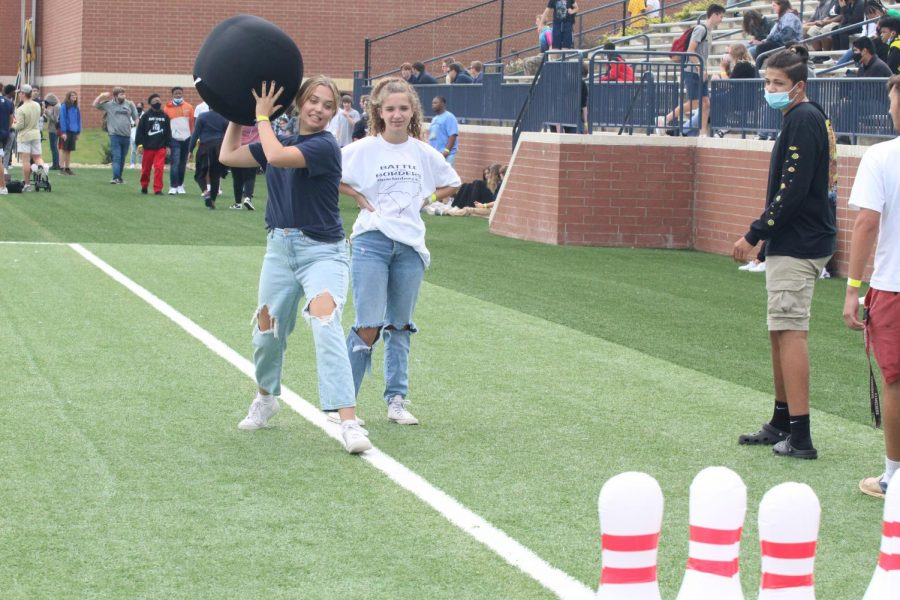 McCall Hope (12) and Addie Kate Martin (11) play giant bowling during Fun Lunch.