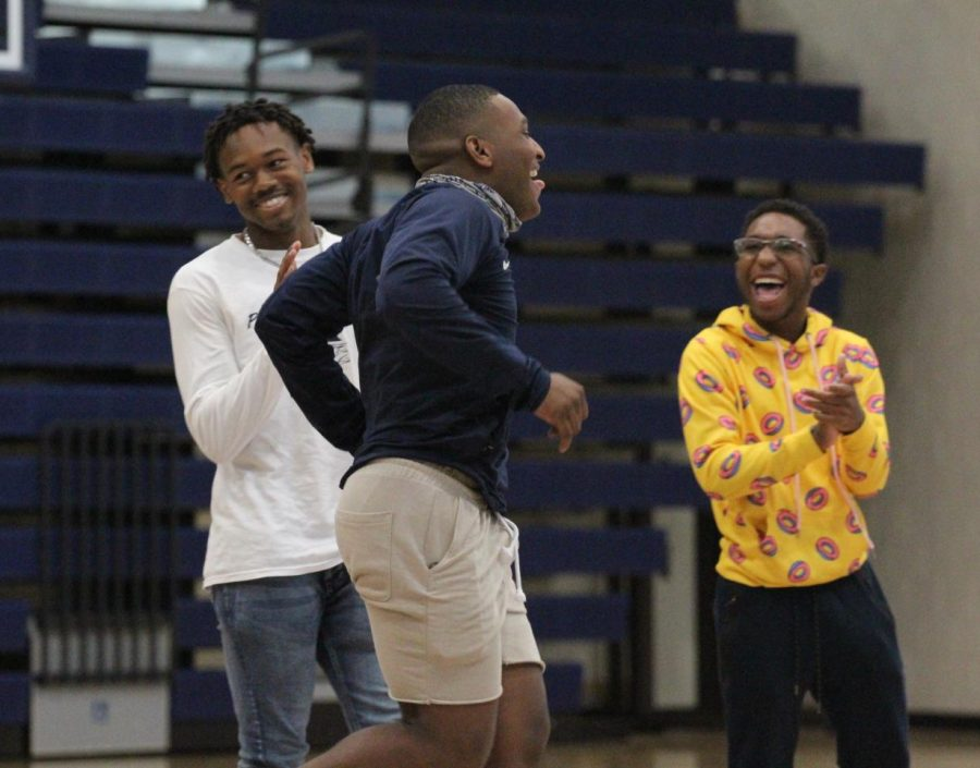 Homecoming King candidates cheer as the winner, Kanye Richards (12), is announced.