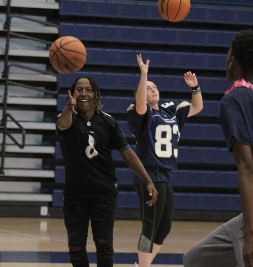 Students have fun playing basketball during Fun Lunch.