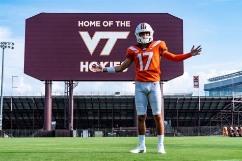 John Love (12) on his official visit tries on the pads and poses in front of the famous Lane Stadium.