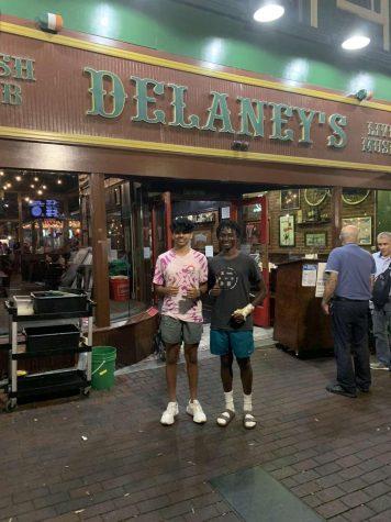 Dev Patel (11) and Lars Harris (11) pose at the entrance of Delaneys Irish Pub.