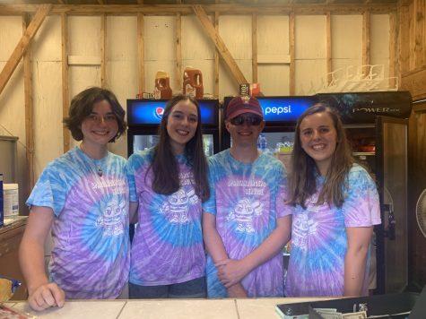 Ella Hammond (11), Savannah Fly (12), Daniel Johnson (11) and Anna Jakubchak (12) sport matching tie-dye shirts while working for the Spartanburgers.